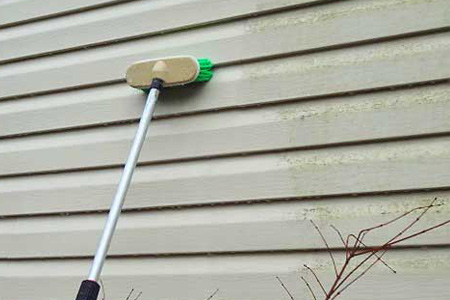 Cleaning Vinyl Siding with Brush